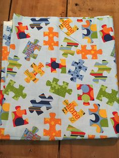 Autism fabric with colorful puzzle pieces on a light blue background. This fabric would be perfect combined with the other pieces in the pieces of hope collection by Riley Blake. OVERVIEW ✂ Blue Puzzle Autism ✂ Size available: Yard: 39x44 ✂ 100% cotton fabric ✂ Condition: Brand New and
