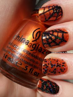 Base Coat of OPI Nail Envy  1 Coat of China Glaze Cross Iron 360  2 coats of Wet n Wild Tangled In My Web on the ring finger  Striper Brush and Wet n Wild Ink Well for the web design  1 Coat of China Glaze Fairy Dust  Top Coat of Out The Door