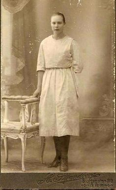 A Finnish young woman, maybe she is a working girl? Why is she holding her left hand back?. Photo is taken in Turku, Finland, by A Strandberg