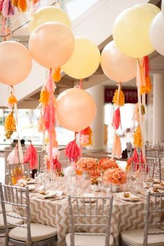 Tasseled balloons make for a unique centerpiece.