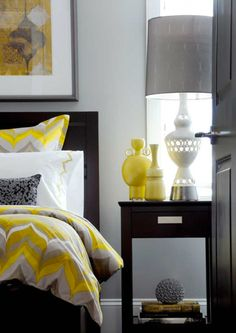 yellow bedroom with grey and white
