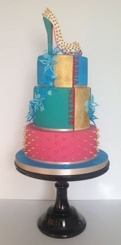 I had total free reign on the design of this cake..my absolute favourite kind of customer!! I was told that Tassia loved Louboutin shoes and that her favourite colour was blue and she didn't like things too girly, other than that I had total freedom to do whatever I liked…Brilliant! These colours looked so lush and bold in real life! White choc mud, lemon and top tier chocolate orange.