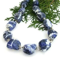 "The elegant ""Sky and Clouds"" handmade gemstone necklace features blue and white sodalite, pewter bead caps and sterling silver - gorgeous one of a kind jewelry. @shadowdog  #indiemade"