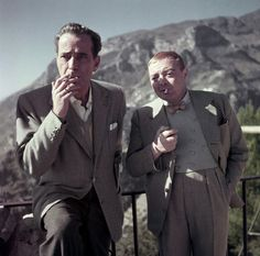 """Robert Capa, Humphrey Bogart and Peter Lorre on the set of """"Beat the Devil"""", Ravello, Italy, 1953"""