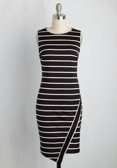 When an entire day of cutting-edge cinema calls for a look of comfort and class, what's a gal to do? Sport this black sheath dress, of course! Enveloping you in structured knit fabric accentuated with white stripes and a wrap-like skirt, this frock stays fresh long after the last credits have rolled.