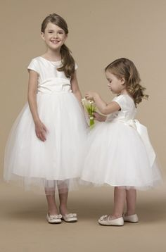 You can have as many flower girls as you want if they look like this! They're in Us Angels!