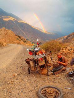 Roadside repair under rainbow