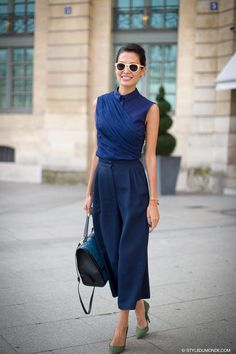 Shop this look on Lookastic:  http://lookastic.com/women/looks/sunglasses-short-sleeve-blouse-wide-leg-pants-satchel-bag-pumps/5646  — Beige Sunglasses  — Navy Short Sleeve Blouse  — Navy Wide Leg Pants  — Teal Leather Satchel Bag  — Green Suede Pumps