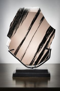 Looking like glass, but coming from a volcano. This polished slice of Midnight Lace Obsidian is a piece of lava from a Caucasian volcano that has been cooling down very fast, so that no crystals could grow. This mineral is rather new on the market, as it is hard to reach this area due to political reasons. This obsidian is mostly
