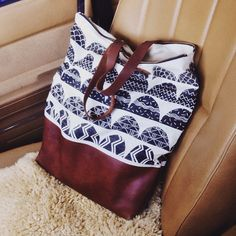 Block printed leather carry all bag