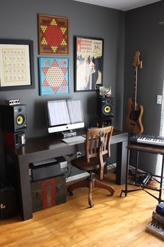 wouldn't mind this desk setup for a home music room. guitars, speakers, keyboards. everything you need!