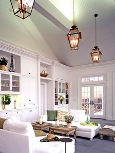 Level out the top of the room with moulding and then ceiling treatment is not so overpowering