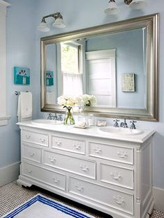 "Small bathroom.  Large mirror increases ""visual space"" and bounces light around the room."