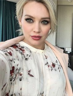 Who made Hillary Duff's jewelry, clutch handbag, nude lace up sandals, and floral dress?