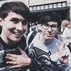 Dan looks like a fan girl who ran into phil and took a picture