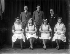 A hospital or nursing home group taken somewhere in Waterford, Ireland. The gentleman on the right was Dr Vincent White, and the other two men were Dr Halley and Mr F. Murphy (women unidentified). March 5, 1946.