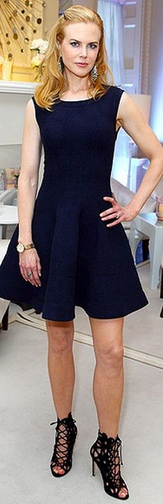 Who made Nicole Kidman's gold watch, black lace up boots and blue fit and flare dress that she wore in London? Dress - Azzedine Alaia Watch - Omega Shoes - Manolo Blahnik