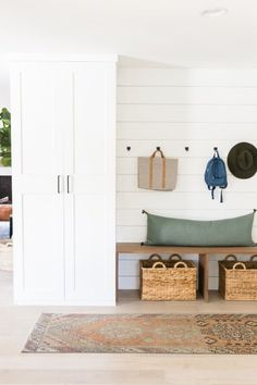 Custom mudroom using two IKEA Pax wardrobes. Get a built-in look by installing a. Custom mudroom using two IKEA Pax wardrobes. Get a built-in look by installing a crown molding, a c Ikea Pax Wardrobe, Ikea Closet, Pax Closet, Entry Closet, Decoration Hall, Casual Family Rooms, Ikea Built In, Built In Bench, Mudroom Laundry Room