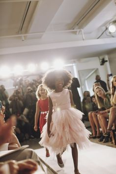 During Oscar de la Renta's first children's wear show. This Ebony princess looks darling in her rose/blush pink dress. Perfect look for a flower girl.
