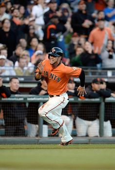 SAN FRANCISCO, CA - JUNE 21: Gregor Blanco #7 of the San Francisco Giants races around third base to score on an RBI double by teammate Marco Scutaro #19 in the third inning against the Miami Marlins at AT Park on June 21, 2013 in San Francisco, California. (Photo by Thearon W. Henderson/Getty Images)