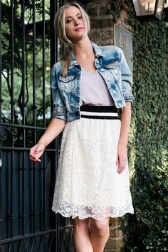 """Feel flirty & feminine wearing the Abbiegale Lace Midi Skirt. A delicate ivory lace makes up this a-line midi skirt finished with a bandaged waist. Finish off your look with a pair of booties & a denim jacket.<br /> <br /> - 24"""" length<br /> - 12"""" waist<br /> - 29"""" sweep<br /> - measured from a size small<br /> <br /> - 100% Polyester<br /> - Hand Wash<br /> - Imported<br /> <br /> <br />"""