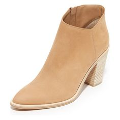 Easton booties by Vince. An asymmetrical top line updates these pointed toe Vince booties. Exposed side zip. Stacked heel ...