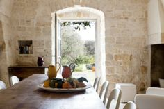 Trullo Rosmarino - elegant holiday trulli with pool in Puglia The indoor dining area with its access to the gardens at the front of the house.