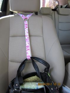 Awesome way to hold your purse/bag in the car! No more spilled stuff on the floor if you have to stop fast!