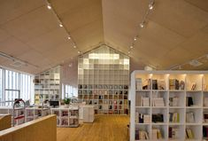 xi'an den IMC bookstore coffee + gallery + j little theater by approach architecture studio - designboom