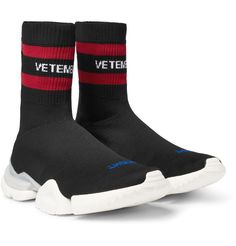 Vetements' Sock Pump' all started with a trip to the Reebok archives in Canton, Massachusetts. There, Mr Demna Gvasalia spotted an unreleased prototype sneaker from 1996 and was sold on the split-tooled sole. The same rubber ones are fitted to this design, which is knitted with sock-like uppers from lightweight stretch-knit. They're finished with trademark ...