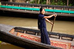 Woman driving a boat in Nyaung Shwe. Myanmar