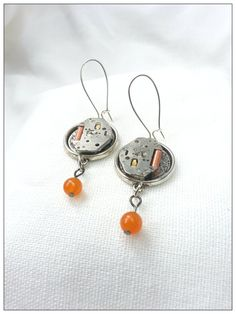 Watch Movement Earrings with Orange Beads and by PalindromeCircus, $25.00
