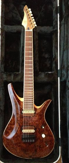 Nolly's Vik 7 strings - nice wood body, but it seems that the design feature on the left of guitar body (depression) may be limiting right hand motion.