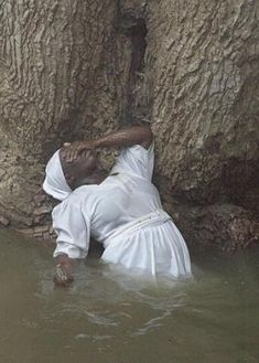 A woman vodoo believer possessed by a spirit at the sacred pool at Sucry near Gonaives, Haiti, on Thursday, Aug. 15, 2002.