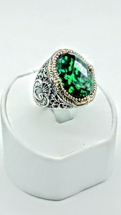 This beautiful mens ring is made of 925 sterling silver. Emerald stone is added carefully.If you are looking for a real Turkish handcrafted gift,this ring is a good option.  WEIGHT 16 Gram  STAMP All our products are 925 sterling silver and stamped.  RESIZING When you buy a ring from our store, resizing is FREE. Please let us know your size after you placed your order.  SHIPPING We ship the items in 1 working time after payment clearence through registered air mail.Please let us know if you…