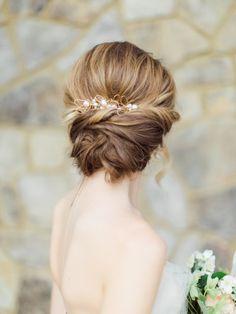 Elegant loose low bun hairstyle: http://www.stylemepretty.com/virginia-weddings/2016/09/08/romantic-spring-editorial-wedding-inspiration/ Photography: Rachel May - http://rachel-may.com/