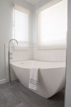 Free standing tub with floor mount tub filler
