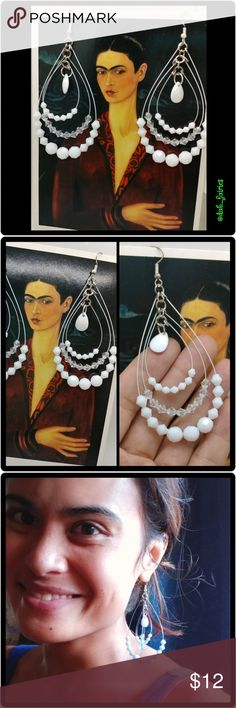 White beaded tear drop earrings Beautiful Nwt fashion  white teardrop beaded dangling  earrings. Message me for more details, offers or personalized bundles. Thank you for looking and have a great day. #jewelry#earrings #fashion  #teardrop #dangle #nwt #new #white #beads #fashionearrings #bundleandsave #fashiononabudget #iloveoffers dab_fairies Jewelry Earrings