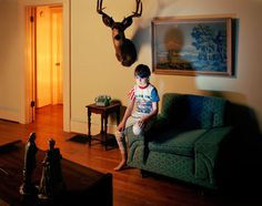 Holly Andres | An ex in-law had that very same chair with matching sofa. The stag trophy hangs here though.