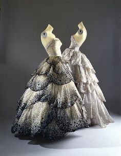 """""""Venus"""" - """"Venus"""" Design House: House of Dior (French, founded 1947) Designer: Christian Dior (French, Granville 1905–1957 Montecatini) Date: fall/winter 1949–50 Culture: French Medium: silk, sequins, rhinestones, simulated pearls Dimensions: (a) Length at CB: 4 in. (10.2 cm) (b) Length at CB: 49 in. (124.5 cm) (c) Overall: 1 1/2 x 5 in. (3.8 x 12.7 cm) Credit Line: Gift of Mrs. Byron C. Foy, 1953"""