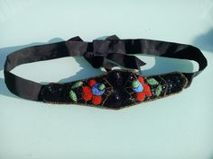 A personal favourite from my Etsy shop https://www.etsy.com/uk/listing/230545099/vintage-beautiful-beaded-belt