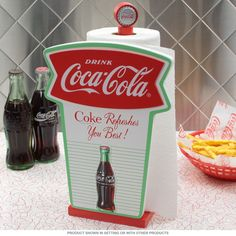 A Coca-Cola ® paper towel holder with the classic fishtail logo and pastel colors. This decorative wooden holder will clean up any retro kitchen or diner decor. Also makes a unique gift for your favorite Coke ® fan. Measures 8W x 6H x 13D inches.