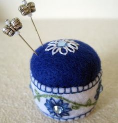 Happiness is Cross Stitching : Bottle cap pin cushion
