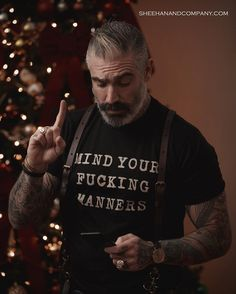 """Remember this year to """"Mind Your Fucking Manners"""" be present and get that gift for the person who needs a little social encouragement! Check out of cool tees and leather accessories! Order this weekend and get in time to put underneath the tree! Daniel Sheehan, Beautiful Men, Beautiful People, Order T Shirts, Beard Tattoo, Tattoo Ink, Tattoos, Hipster, Cool Tees"""