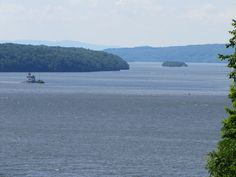 View of the Hudson River & lighthouse from Wilderstein Historic Site, NY in Rhinebeck, NY