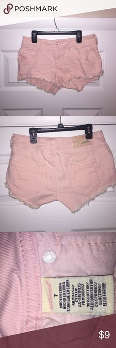 Light Pink Dollhouse Shorts These shorts are in perfect condition! NWOT. Purchased a couple years ago and never ended up wearing them. They are a Size 7. Light pink and frayed at the bottom. Super stylish and can be paired with many different tops! Dollhouse Shorts