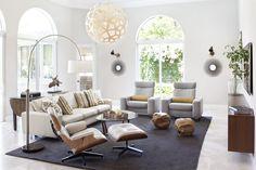 modern living room, floating credenza, arc floor lamp, eames lounger