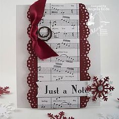 big sheet music panel down the center, edged with border punch