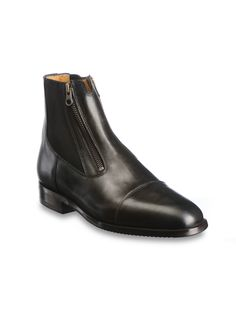 Daily Life Collection   Short boot in black leather with elastic side inserts and two front zippers.   Short boots are produced using Italian calfskin inside and out, with hand-sewn …