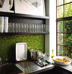I like how the green tile in the kitchen brings in the greenery from outside right here.
